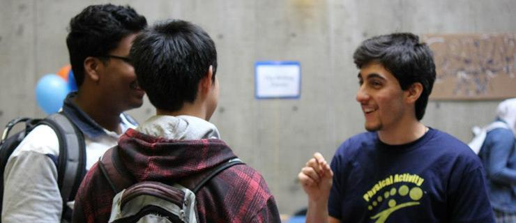 Students talking to a representative at the Experience UTSC Fair