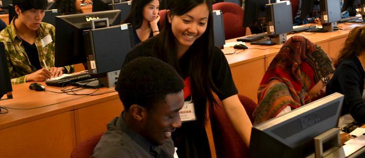 Student getting advice while looking at a computer