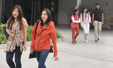Students walking on campus in summer