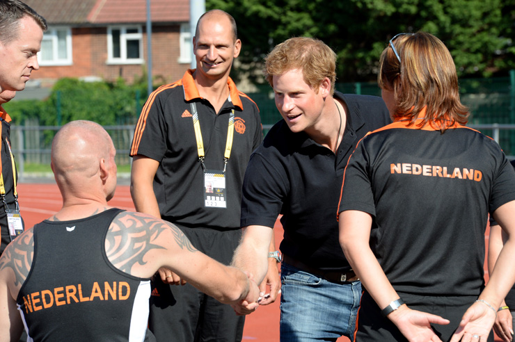 Britain's Prince Harry greets competitors from the Netherlands while observing the final practice sessions before the start of the 2014 Invictus Games. Invictus Games is an international competition that brings together wounded, injured and ill service members in the spirit of friendly athletic competition. American Soldiers, Sailors, Airmen and Marines are representing the United States in the competition which is being held in London, England from 10-14 September 2014. (U.S. Navy photo by Mass Communication Specialist 2nd Class Joshua D. Sheppard/Released)
