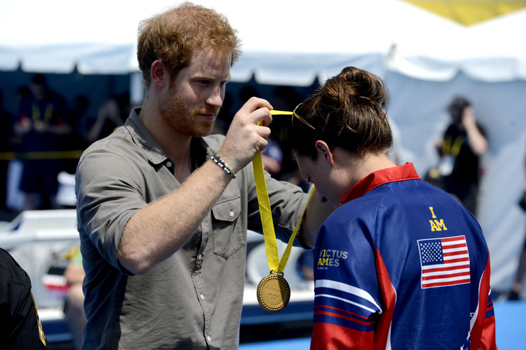 Prince Harry presents the gold medal to U.S. Army Sgt. Elizabeth Marks, member of Team U.S. at the swimming finals for the Invictus Games 2016 in Orlando, Fla. May 11, 2016. The Invictus Games are composed of 14 nations, over 500 military competitors, competing in 10 sporting events May 8-12, 2016. (U.S. Air Force photo by Staff Sgt. Carlin Leslie/Released) Unit: Secretary of the Air Force Public Affairs
