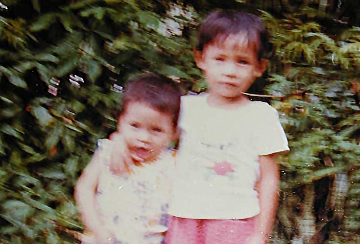 Nhung and Chi, Singapore refugee camp, 1979.