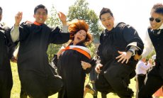 Graduates at convocation jumping.