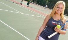 Anna Sullivan on tennis court