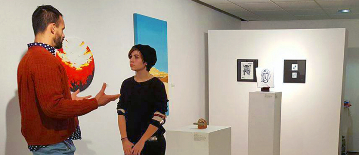 Manolo (staff) and Caitlyn (student) at a gallery opening at Gallery 1265.