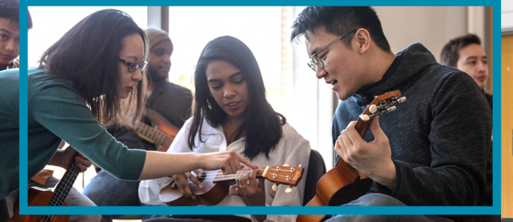 Beginners learning to play ukuleles