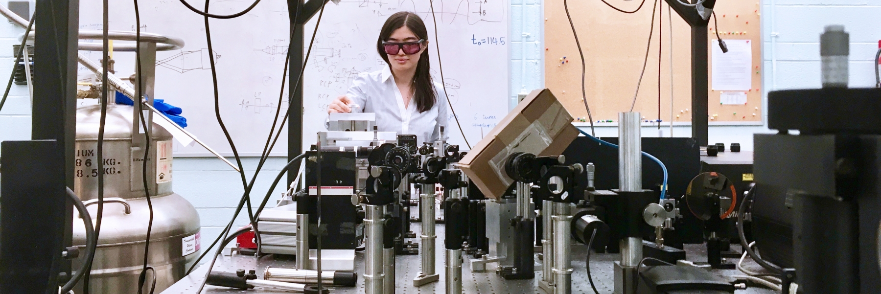 student in physics lab