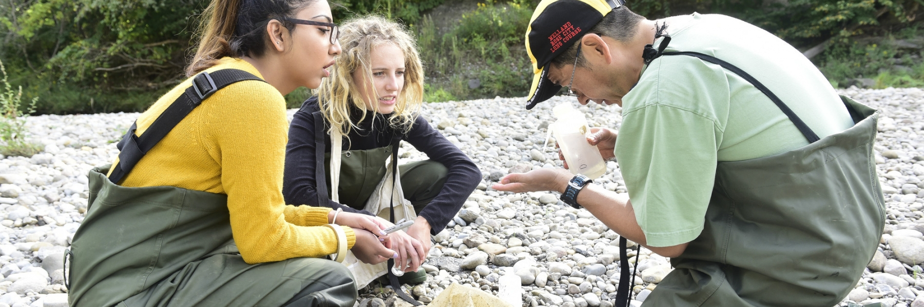 students in on a river shore