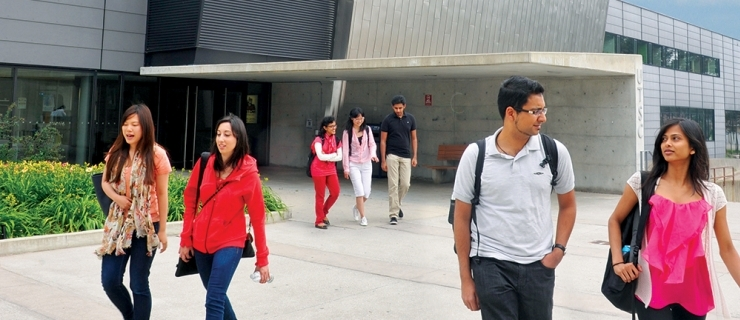 Students walking in front of the student centre