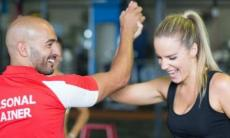 Personal trainer Cheering on Client