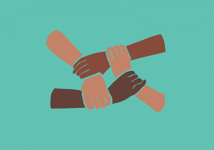 Four racialized hands connecting at the wrist