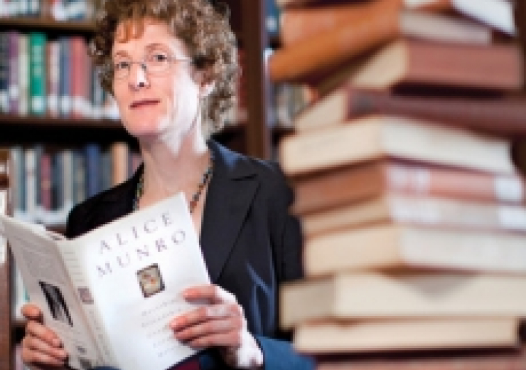 professor marlene goldman beside stack of books