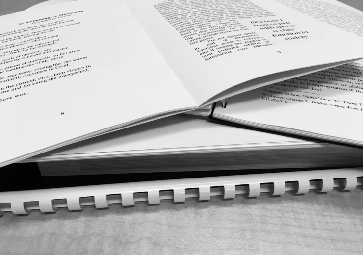 stack of paper publications in black-and-white