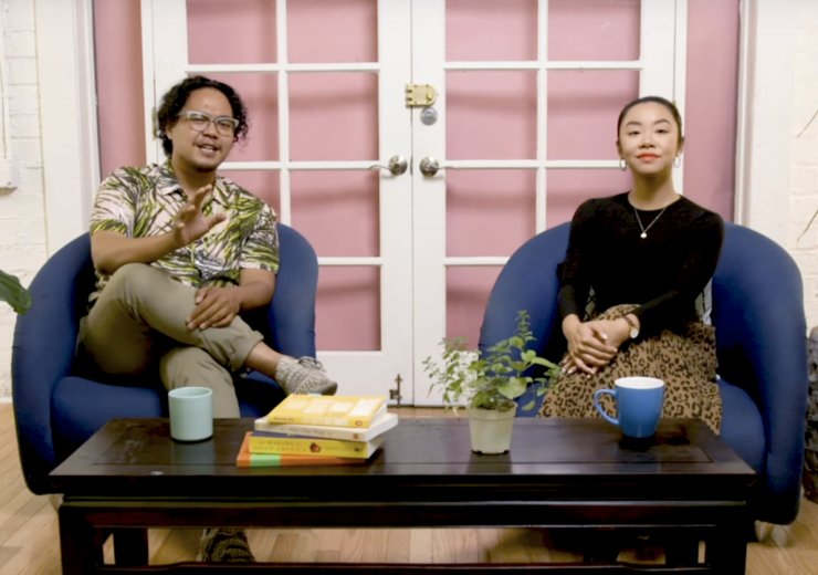 Adrian De Leon and Dolly Li on a couch, talking for PBS digital studios