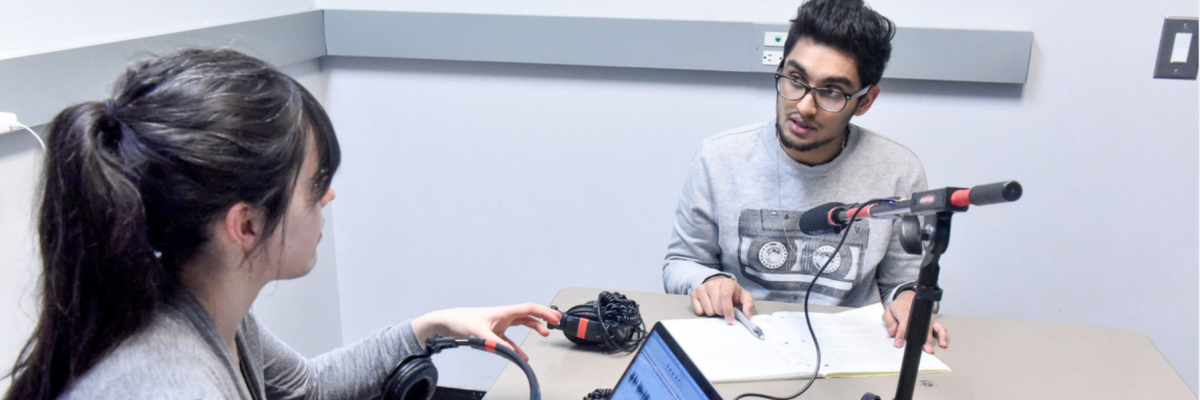 Two students recording a podcast