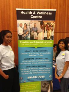 Health & Wellness Centre Banner and 2 Mental Wellness Peer Educators