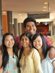 4 students smiling