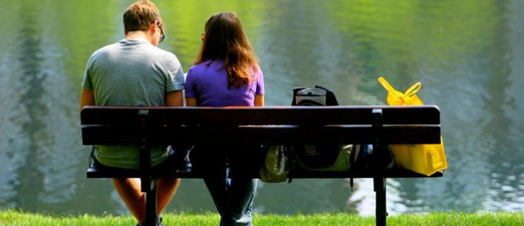 Two student sitting on a bench talking