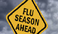 caution sign with text flu season ahead