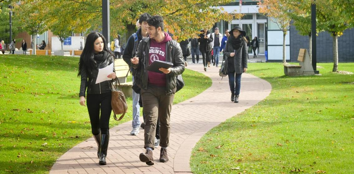 U of T Scarborough students take in the fall colours on campus