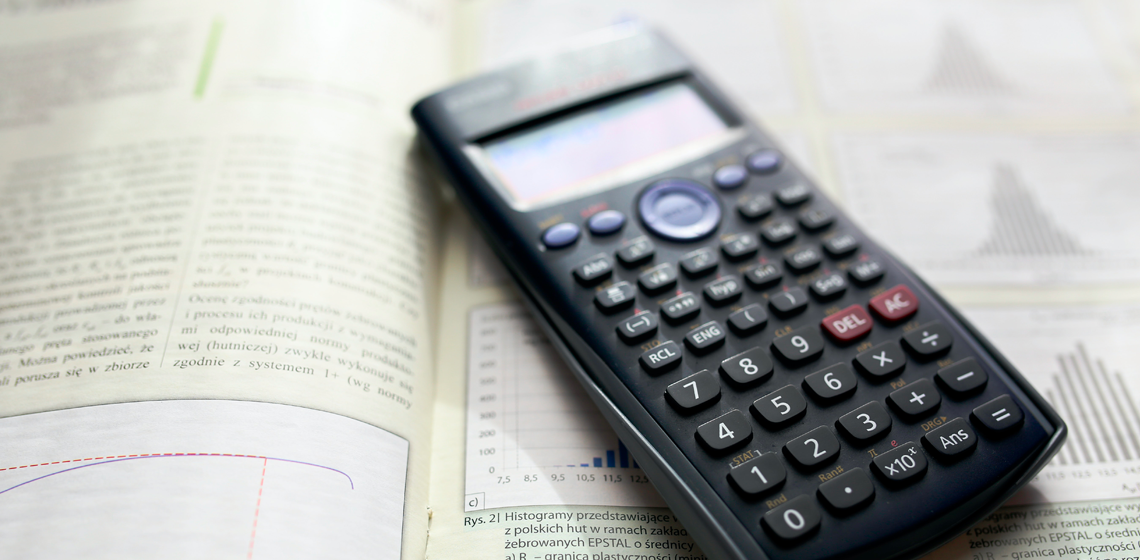 A mathematics textbook and a calculator