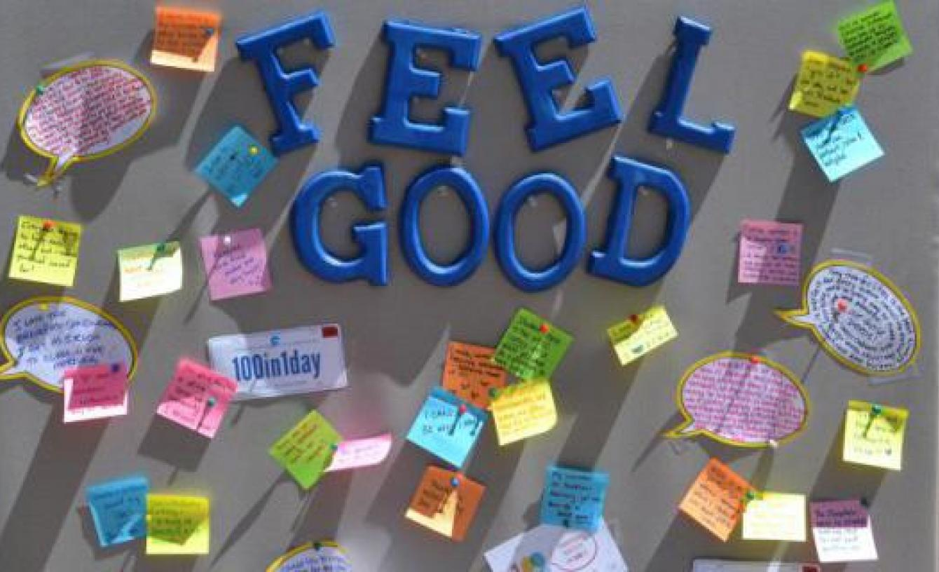 """a picture of a bulletin board that has """"Feel Good"""" on it along with post it notes"""