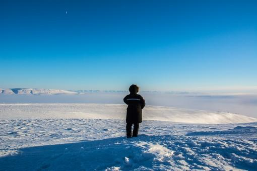 A PEARL researcher takes a moment to look out on the stunning Canadian Arctic landscape near Eureka. The high Arctic's environment is expected to change significantly due to climate change.