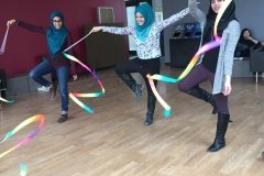 Student performing rhythmic gymnastics routines with ribbons