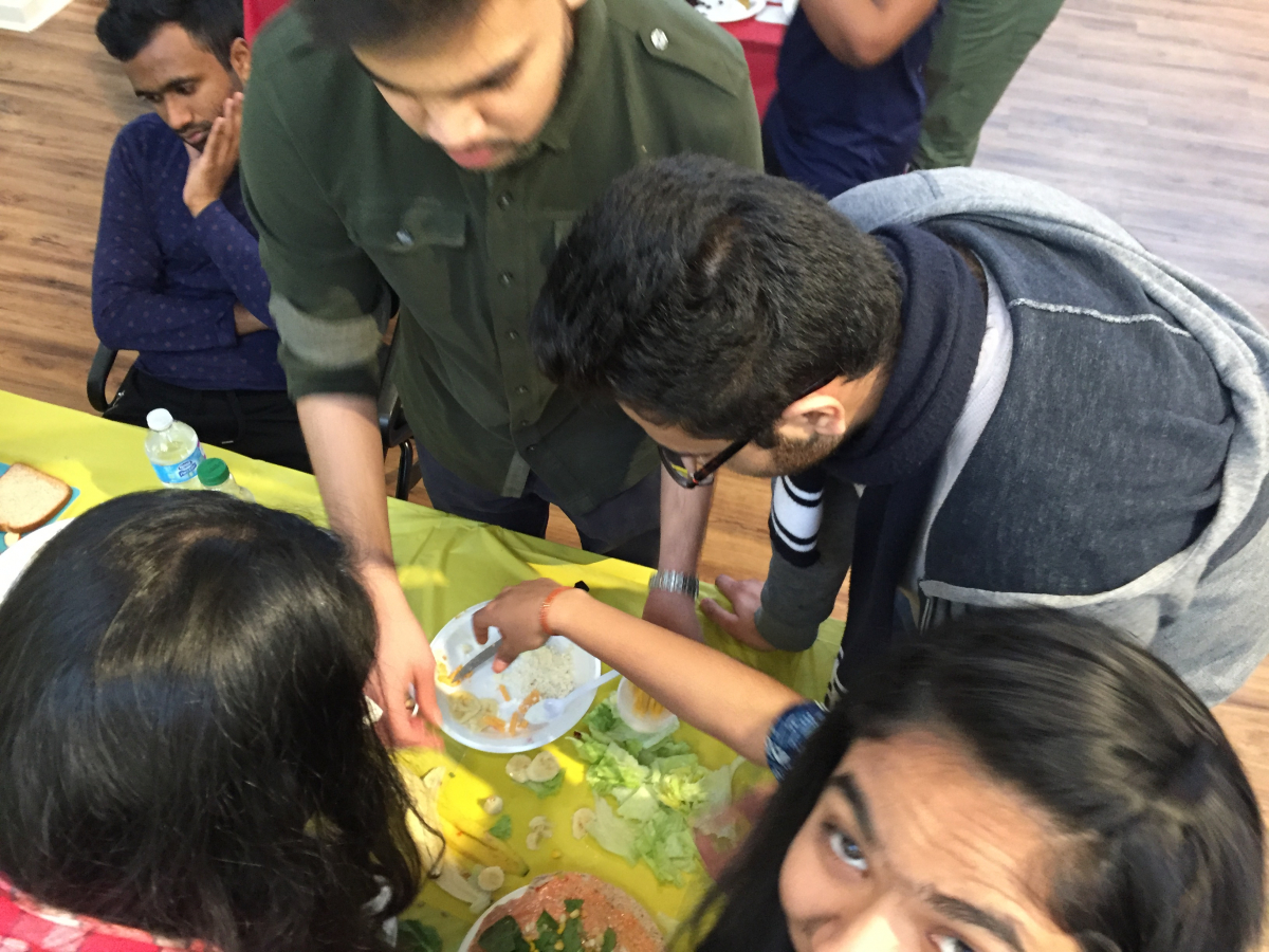 Teams working together to create a delicious wrap
