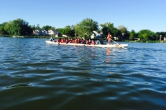 Candid photo of students on a dragon boat