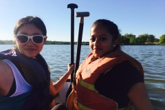 Two students secured with life jackets on the boat