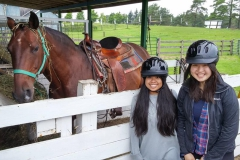 Two students ready to go horseback riding