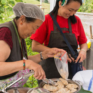 two-women-preparing-chicken
