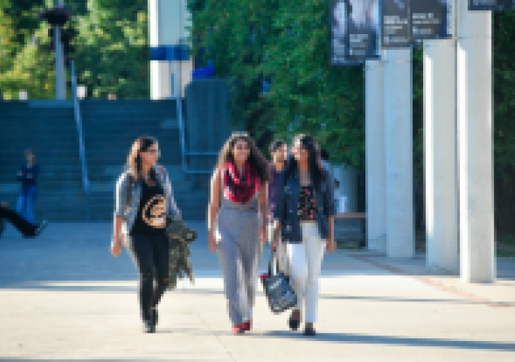 Students walk on a path at UTSC.