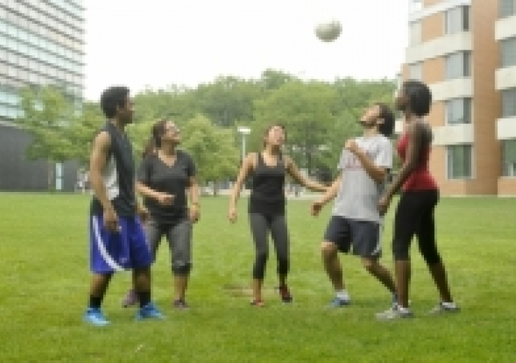 Students play with a ball.