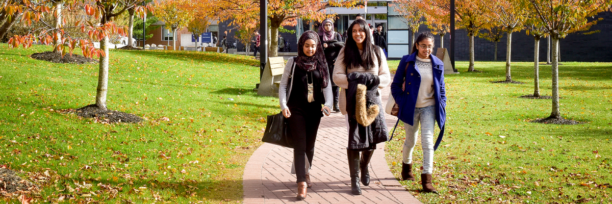 U of T Scarborough students walking outside on campus in the fall