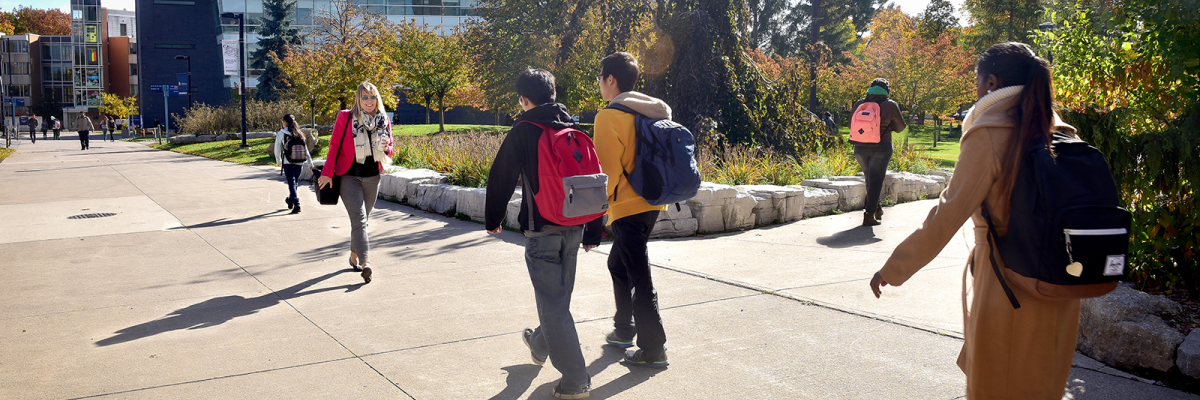 Students walking outside in the fall