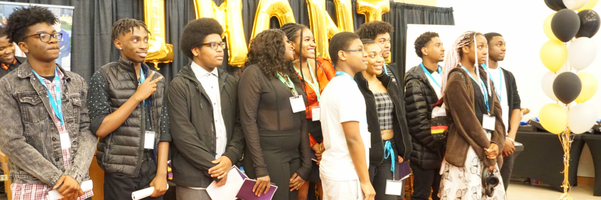 Students taking a picture at an Imani event