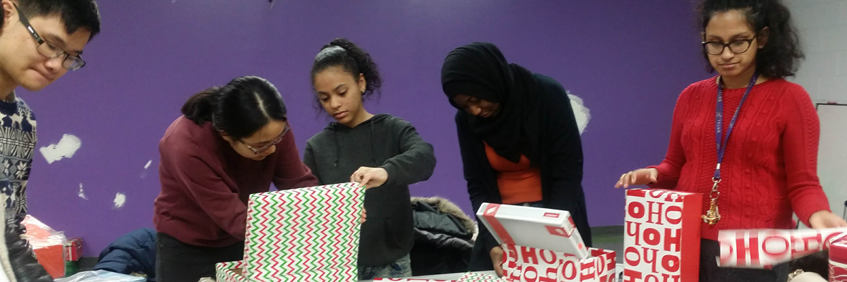 Students wrapping gifts