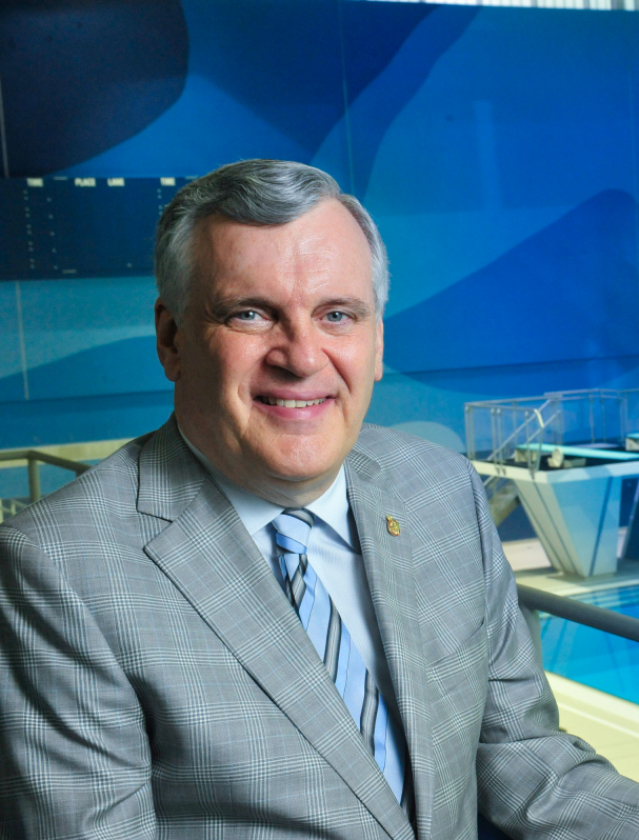 David Onley overlooking diving pool at Pan Am Centre